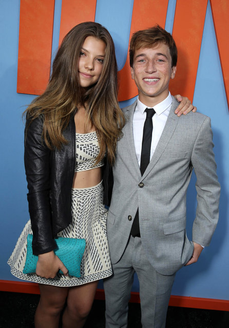 """Catherine Missal and Skyler Gisondo seen at the New Line Cinema presents the Premiere of """"Vacation"""" held at Regency Village Theatre on Monday, July 27, 2015, in Westwood, Calif. (Photo by Eric Charbonneau/Invision for Warner Bros./AP Images)"""