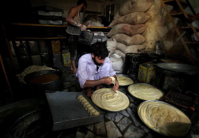 A baker prepares dough for bread ahead of Ramadan in Peshawar, Pakistan, May 31, 2016. (Photo by Faisal Mahmood/Reuters)