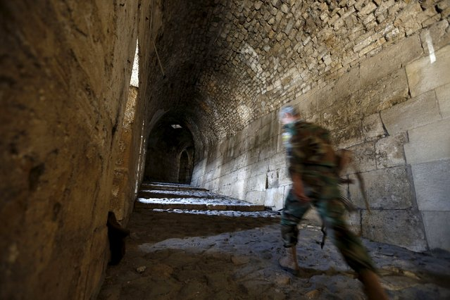 A Syrian army soldier walks inside the Crac des Chevaliers, a UNESCO World Heritage site, in the Homs countryside, Syria August 2, 2015. Syria's tourism minister Bishr Yazigi announced on Sunday the re-opening of the Crac des Chevaliers for tourists and the start of the al-Wadi festival. (Photo by Omar Sanadiki/Reuters)