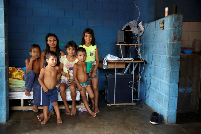 Sharon Roa (2nd L), 27, poses for a picture with her children at their house in La Fria, Venezuela, June 2, 2016. (Photo by Carlos Garcia Rawlins/Reuters)