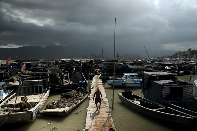 A fisherman walks at a port as Typhoon Soudelor approaches, in Ningde, Fujian province, August 7, 2015. (Photo by Reuters/Stringer)