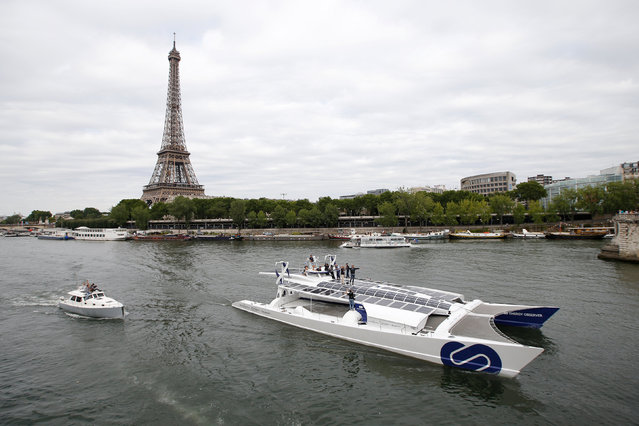 Energy Observer, the first self-sustainable eco-friendly boat, travels on the Seine river next to the Eiffel tower as it leaves for a world tour, in Paris, France July 15, 2017. (Photo by Stephane Mahe/Reuters)