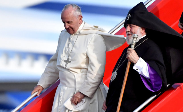 Pope Francis and Catholicos of All Armenians Karekin II step off a plane upon their arrival at Yerevan's Zvartnots Airport  June 25, 2016. (Photo by Tiziana Fabi/Reuters)
