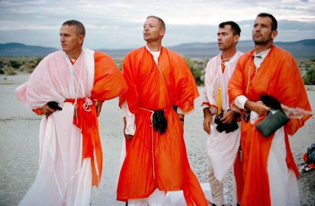 Astronaut John Young, Frank Borman and Neil Armstrong with Deke Slayton are shown during desert survival training, Reno, Nevada STEAD AFB, Reno, NV, on August 13, 1964. Portions of their clothing have been fashioned from parachute material. The purpose of this training was to prepare astronauts in the event of an emergency or faulty landing in a remote area.