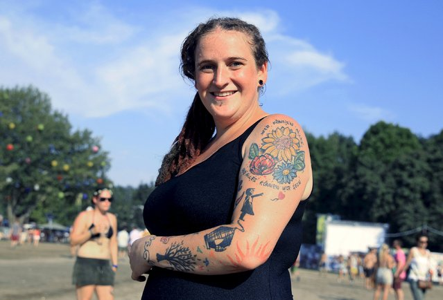 Bianca Womer, 29, from Germany shows her tattoo during the Sziget music festival on an island in the Danube River in Budapest, Hungary, August 14, 2015. (Photo by Bernadett Szabo/Reuters)