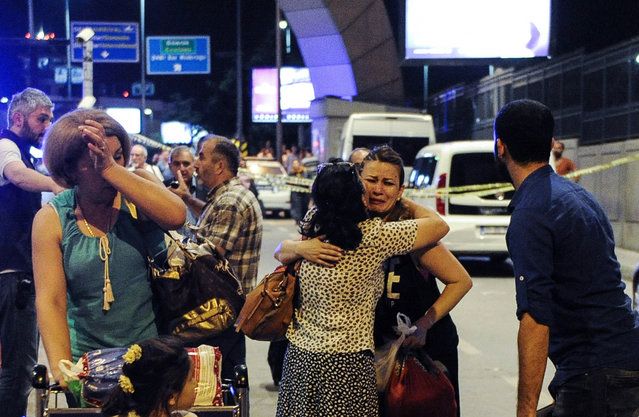 Passengers who survived from the suicide bomb attack cry as they leave the Turkey's largest airport, Istanbul Ataturk, June 28, 2016, Turkey. (Photo by Gokhan Tan/Getty Images)