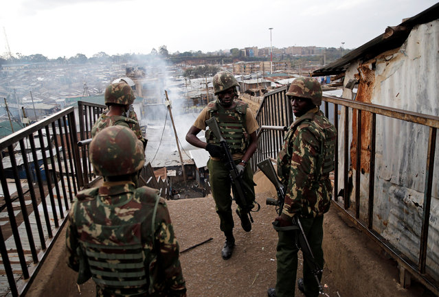 Anti-riot police officers deploy in Mathare, in Nairobi, Kenya August 9, 2017. (Photo by Thomas Mukoya/Reuters)