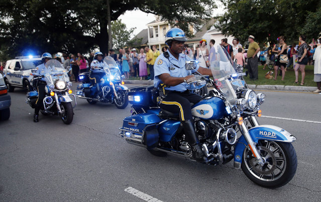 "This June 18, 2016, file photo shows Police escorts leading out the start of the ""New Orleans Pride"" parade, a gay pride parade, in New Orleans. Organizers expect big crowds and authorities plan tight security for Cincinnati's parade and festival events celebrating Gay, Lesbian, Bisexual and Transgender Pride Month. The celebration will occur amid the same kind of increased security put in place last weekend at gay pride events in more than a half dozen cities, including Chicago, Denver and New Orleans. (Photo by Gerald Herbert/AP Photo)"