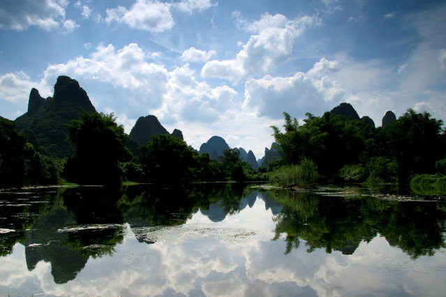 File photo taken on Aug. 14, 2011 shows the scenery of karst landform in Yangshuo County of Guilin, south China's Guangxi Zhuang Autonomous Region. The World Heritage Committee on Monday inscribed an extension of South China Karst, a natural World Heritage Site since 2007, into the UNESCO's World Heritage List. (Photo by Wang Cuirong/Xinhua)