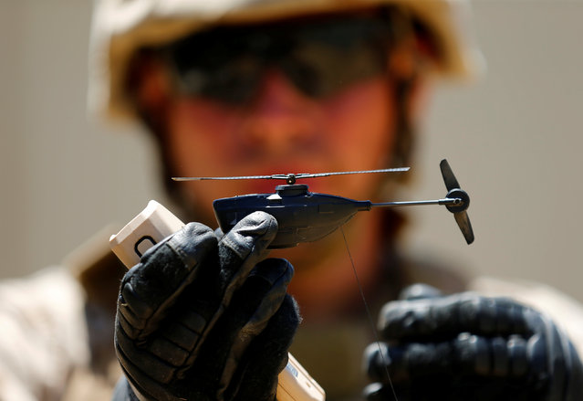 A U.S. Marine shows off a Grp I UAS Black Hornet Drone as part of the Rim of the Pacific (RIMPAC) 2016 exercise held at Camp Pendleton, California United States, July 13, 2016. (Photo by Mike Blake/Reuters)