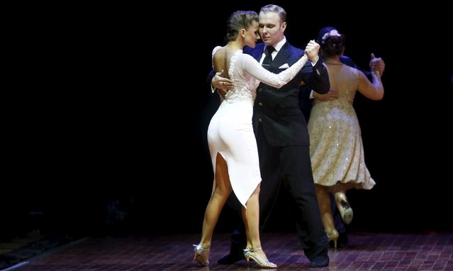 Stanislav Fursov (R) and Ekaterina Simonova from Russia, who are representing the city of Moscow, dance during the Salon style final round at the Tango World Championship in Buenos Aires, Argentina, August 26, 2015. (Photo by Marcos Brindicci/Reuters)