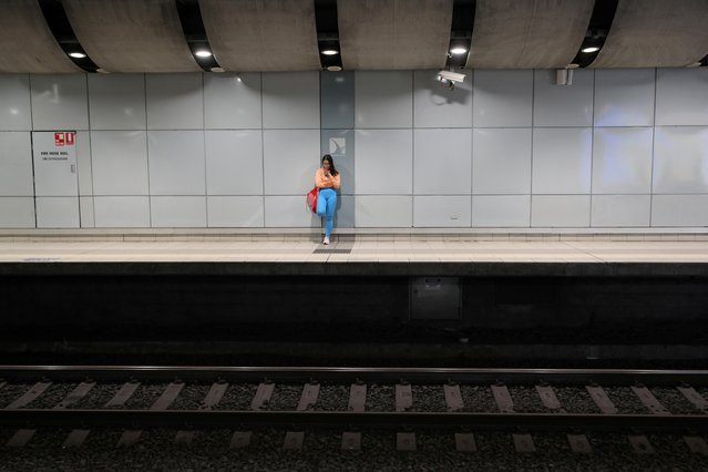 """A lone commuter stands on the platform of a deserted train station during morning rush hour after New South Wales began shutting down non-essential businesses and moving toward harsh penalties to enforce self-isolation as the spread of coronavirus disease reached a """"critical stage"""" in Sydney, Australia, March 24, 2020. (Photo by Loren Elliott/Reuters)"""
