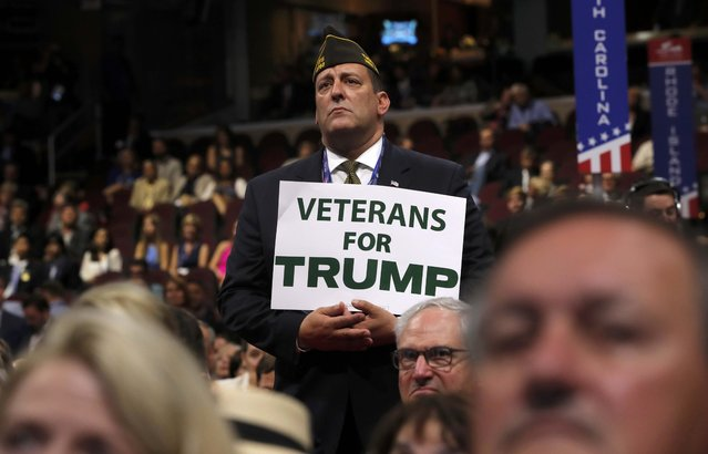 A Trump supporter hold sign at the Republican National Convention in Cleveland, Ohio, U.S. July 18, 2016. (Photo by Brian Snyder/Reuters)