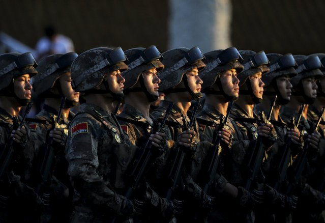 Soldiers of China's People's Liberation Army (PLA) prepare in front of the Tiananmen Gate ahead of the military parade to mark the 70th anniversary of the end of World War Two, in Beijing, China, September 3, 2015. (Photo by Jason Lee/Reuters)