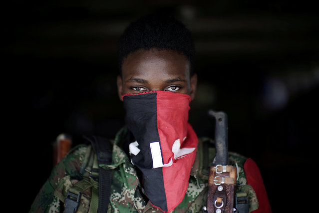 A rebel from Colombia's Marxist National Liberation Army (ELN) poses for a photograph in the northwestern jungles, in Colombia, August 31, 2017. (Photo by Federico Rios/Reuters)