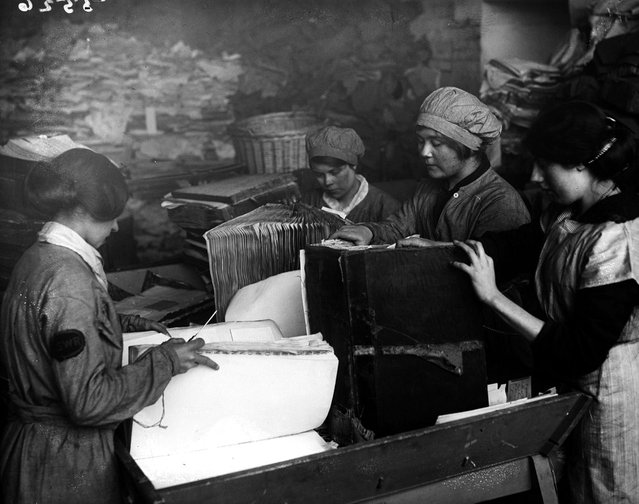 Women pulling apart old ledgers as part of the London & South West Railway's scheme to recycle paper. 16th April 1917. (Photo by Topical Press Agency)