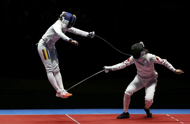 2016 Rio Olympics, Fencing, Final, Women's Epee Team Gold Medal Match, Carioca Arena 3, Rio de Janeiro, Brazil on August 11, 2016. Ana Maria Popescu (ROU) of Romania competes with Xu Anqi (CHN) of China. (Photo by Issei Kato/Reuters)
