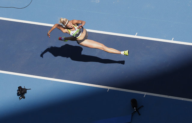 Germany's Jenny Elbe competes during a qualifying round triple jump at the athletics competitions of the 2016 Summer Olympics at the Olympic stadium in Rio de Janeiro, Brazil, Saturday, August 13, 2016. (Photo by Morry Gash/AP Photo)