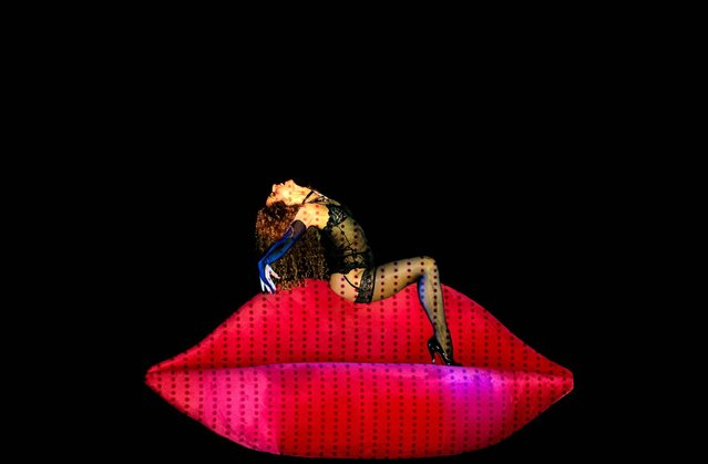 A dancer performs during the cabaret burlesque show Crazy Horse – Forever Crazy show in Rotterdam, The Netherlands, on September 19, 2014. The famous Parisian company which has a nightclub in Paris, is on a world tour and for the first time in The Netherlands. (Photo by Robin van Lonkhuijsen/AFP Photo/ANP)
