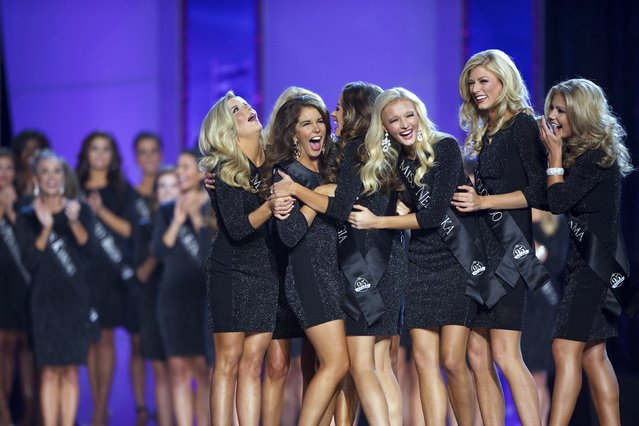 The top 15 Miss America contestants react as they advance to the next round of the competition at Boardwalk Hall, in Atlantic City, New Jersey, September 13, 2015. (Photo by Mark Makela/Reuters)