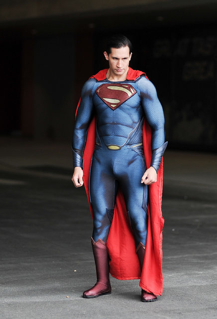 A Comic Con attendee poses as Superman during the 2014 New York Comic Con at Jacob Javitz Center on October 10, 2014 in New York City. (Photo by Daniel Zuchnik/Getty Images)