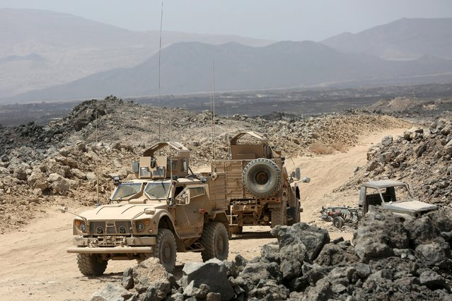Emirati armoured vehicles are seen on the Yemeni front line province of Marib September 20, 2015. (Photo by Reuters/Stringer)