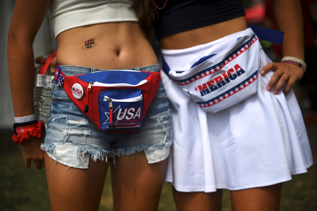 (L) Anna Lena O'Reilly, 18, and Allison Durphee, 18, wear patriotic themed fanny packs during the fifth annual Made in America Music Festival in Philadelphia, Pennsylvania September 3, 2016. (Photo by Mark Makela/Reuters)