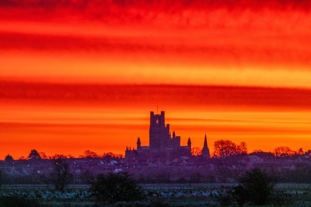 Yesterday, February 28, 2020, dawned to cast a rich hue over the Cambridgeshire Fens before a day of rain and wind. Today wintry showers are expected to spread east. (Photo by Andrew Sharpe/Bav Media)