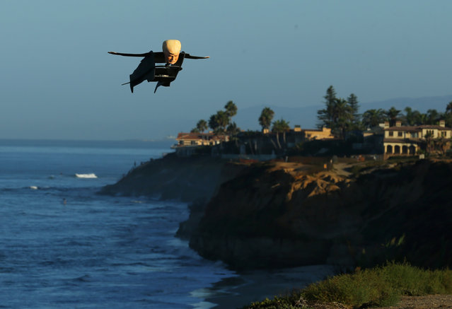 A remote control plane in the shape of U.S. Presidential candidates Donald Trump flies over the beach in Carlsbad, California, U.S. September 15, 2016. (Photo by Mike Blake/Reuters)