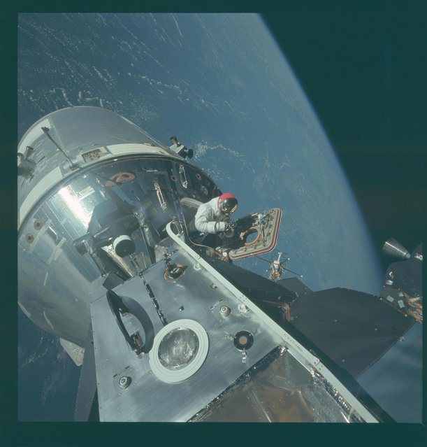 David R. Scott, command module pilot, stands in the open hatch of the Command Module (CM) during extravehicular activity (EVA), on the fourth day of the Apollo 9 Earth-orbital mission in this March 6, 1969 NASA handout photo. (Photo by Reuters/NASA)