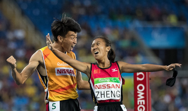 Jin Zheng of China and her guide Yubo Jin celebrate winning the Gold Medal in the Women's 1500m – T11 Athletics Final at the Olympic Stadium. The Paralympic Games, Rio de Janeiro, Brazil, Saturday 17 September 2016. (Photo by Al Tielemans/OIS/IOC)