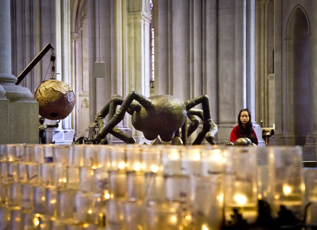 """The steel and bronze sculpture """"The Tables"""", by Tom Otterness, appears among the works of 30 artists in the multimedia exhibition """"The Value of Food: Sustaining a Green Planet"""" at the Cathedral of St. John the Divine, Wednesday, October 7, 2015, in New York.  (Photo by Bebeto Matthews/AP Photo)"""