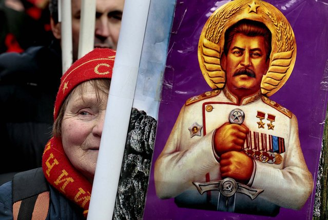 A woman holds a portrait of Josef Stalin during a communist rally in Moscow to mark Defenders of the Fatherland Day, which honors the nation's military and is a nationwide holiday, on February 23, 2013. (Photo by Mikhail Metzel/Associated Press)
