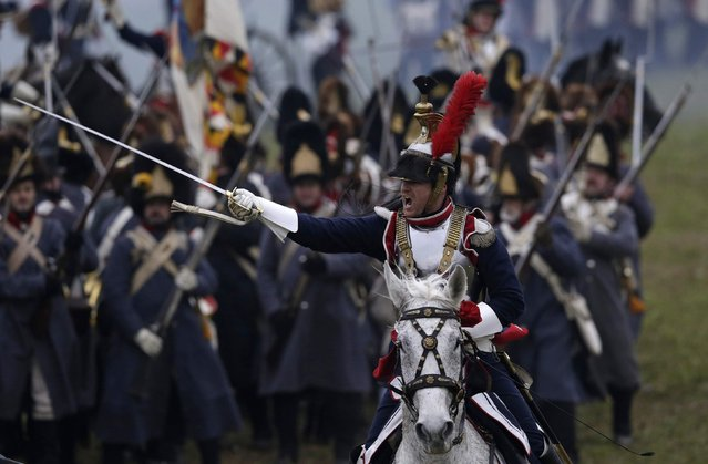 History enthusiasts dressed as soldiers fight during the re-enactment of Napoleon's famous battle of Austerlitz near the southern Moravian town of Slavkov u Brna November 29, 2014. Hundreds of history enthusiasts took part in the re-enactment of the battle to mark its 209th anniversary. (Photo by David W. Cerny/Reuters)