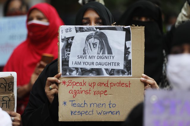 Women hold placards during a protest after the death of a rape victim, on a street in Mumbai, India, October, 6, 2020. (Photo by Francis Mascarenhas/Reuters)
