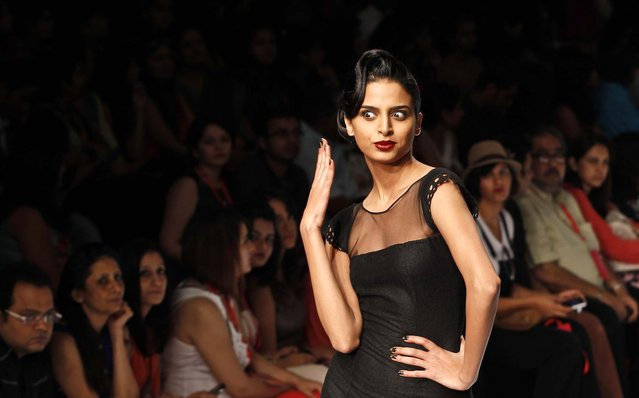 A model displays a creation by Arpan Vohra during the Lakme Fashion Week in Mumbai, India, on March 22, 2013. (Photo by Rajanish Kakade/Associated Press)