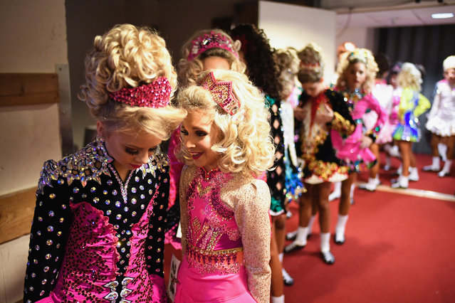 Competitors gather backstage as they prepare to take part in the World Irish Dancing Championships on March 25, 2018 in Glasgow, Scotland. The World Irish Dancing Championships are taking place in Glasgow this week at the Royal Concert Hall, with more than 14,500 dancers and supporters expected to travel to the championships which has run for more than forty years. (Photo by Jeff J. Mitchell/Getty Images)