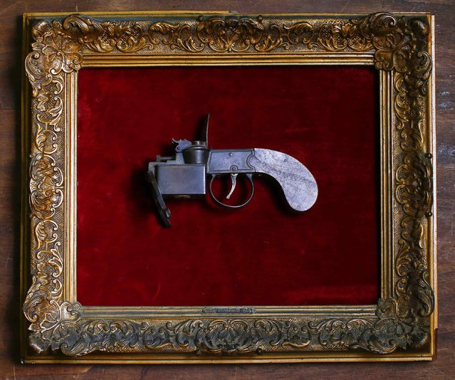 A pistol-shaped lighter dated 1700 is displayed in an old frame in the Museum of Domenico Agostinelli in Dragona, near Rome October 30, 2014. (Photo by Tony Gentile/Reuters)