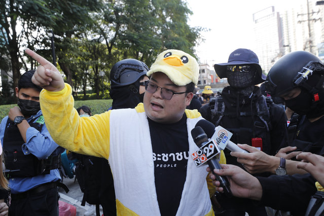 "Protest leader Parit ""Penguin"" Chiwarak speaks to the media while wearing an outfit of a yellow duck, which has become a good-humored symbol of resistance during anti-government rallies, Wednesday, November 25, 2020, in Bangkok Thailand. (Photo by Sakchai Lalit/AP Photo)"