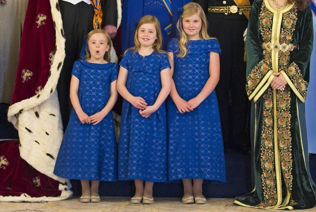 Dutch Crown Princess Catharina-Amalia (L), Princess Ariane (C) and Princess Alexia pose during a photocall at the royal palace in Amsterdam following the crowning ceremonies April 30, 2013. The Netherlands is celebrating Queen's Day on Tuesday, which also marks the abdication of Queen Beatrix and the investiture of her eldest son Willem-Alexander. (Photo by Michel Porro/Reuters)