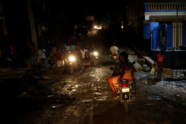 Motorcyclist drive on the street after Hurricane Matthew hit Jeremie, Haiti, October 15, 2016. (Photo by Carlos Garcia Rawlins/Reuters)