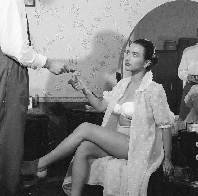 1956:  A client paying a prostitute at a brothel in Guatemala City, capital of Guatemala.  (Photo by Evans/Three Lions/Getty Images)