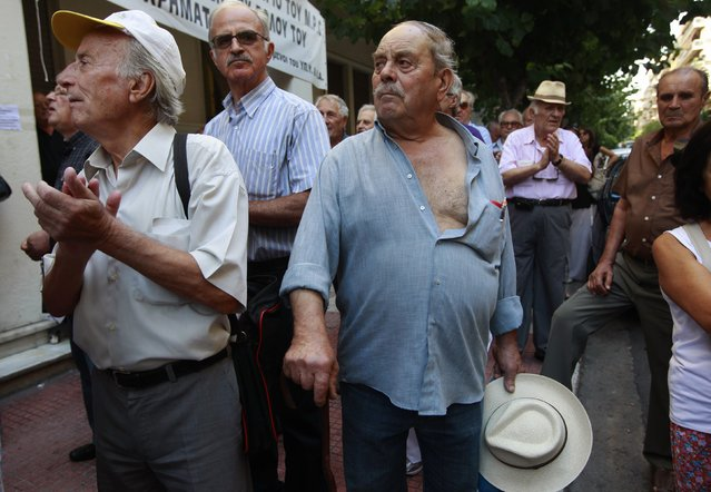 Pensioners applaud in front of the Health Ministry as they take part in an anti-austerity rally in Athens in this September 4, 2012 file photo. (Photo by John Kolesidis/Reuters)