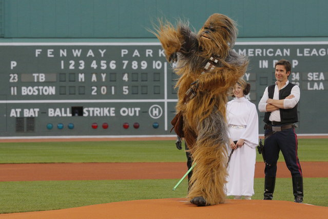 People dressed as Star Wars characters Chewbacca, Princess Leia and Han Solo throw out the ceremonial first pitch before the game between the Tampa Bay Rays and the Boston Red Sox at Fenway Park in Boston, May 4, 2015. (Photo by Brian Snyder/Reuters)