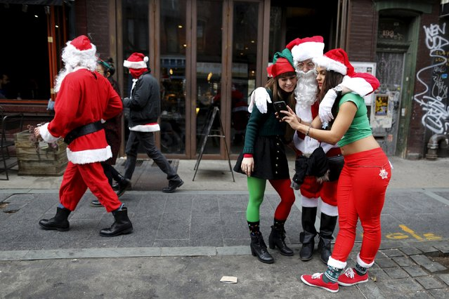 Revelers dressed in Santa Claus and other holiday themed outfits take part in the annual SantaCon event in the Brooklyn borough of New York. December 12, 2015. (Photo by Brendan McDermid/Reuters)