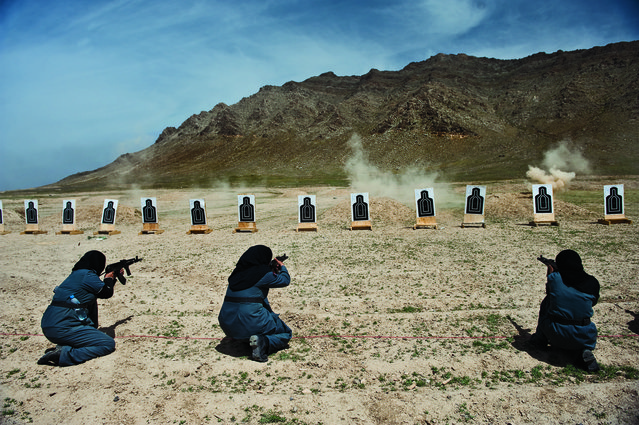 Wome, mostly widows, train for police force jobs at a firing range near Kabul, Afghanistan, April 13, 2010. (Photo by Lynsey Addario/VII Network/National Geographic)