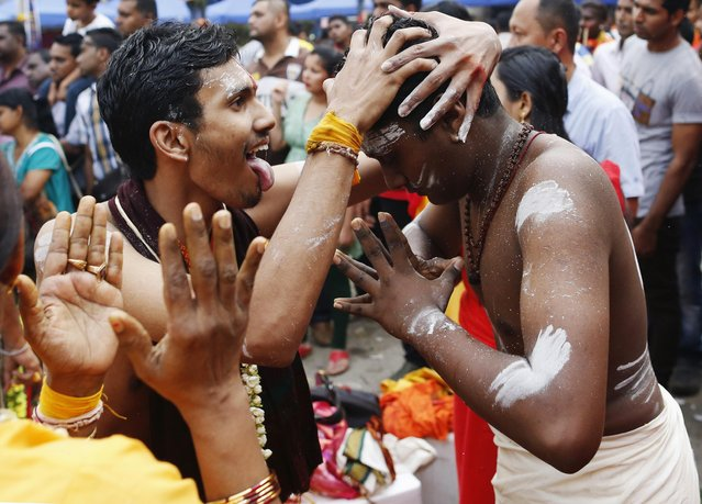 Hindu devotees go into a trance before starting their pilgrimage to the Batu Caves temple during Thaipusam in Kuala Lumpur February 2, 2015. (Photo by Olivia Harris/Reuters)