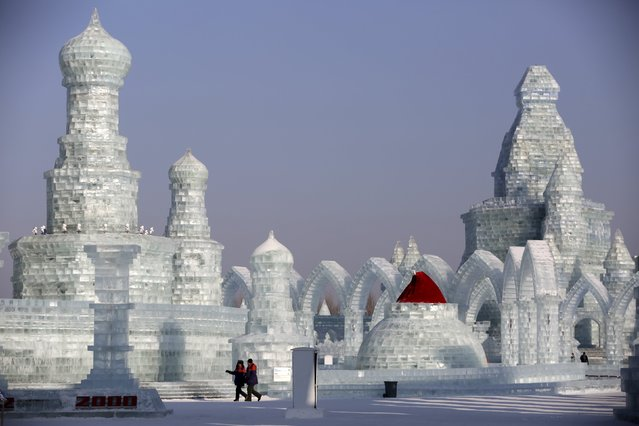 People look around ice sculptures ahead of the Harbin International Ice and Snow Festival in the northern city of Harbin, Heilongjiang province, January 4, 2016. (Photo by Aly Song/Reuters)