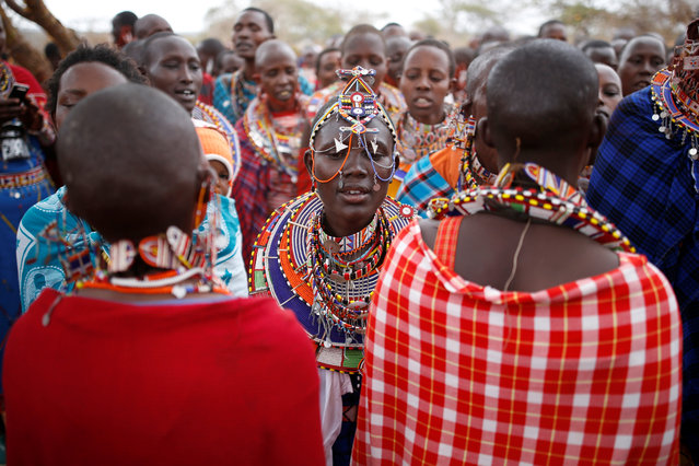 A Maasai woman dances during an initiation into an age group ceremony near the town of Bisil, Kajiado county Kenya on August 23, 2018. (Photo by Baz Ratner/Reuters)