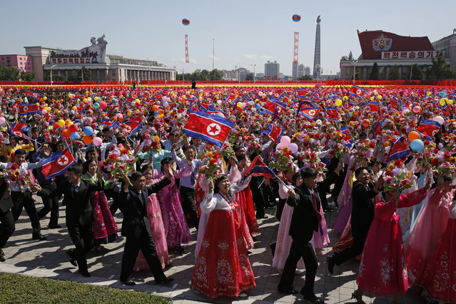Participants march during a parade for the 70th anniversary of North Korea's founding day in Pyongyang, North Korea, Sunday, September 9, 2018. North Korea staged a major military parade, huge rallies and will revive its iconic mass games on Sunday to mark its 70th anniversary as a nation. (Photo by Kin Cheung/AP Photo)